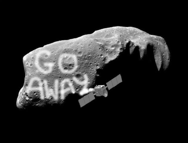 """Надпись """"Убирайся!"""" на угрожающем Земле астероиде вряд ли спасёт планету от столкновения, а полная закраска его поверхности вполне может привести к изменению траектории полёта (иллюстрация NASA/Hyland D. et al., Wired)."""