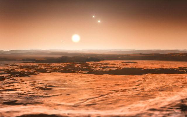 Пейзаж суперземли планетарной системы Глизе 667С в представлении художника (иллюстрация ESO).