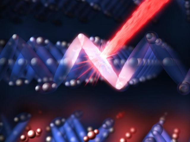 Красный лазер видимого света, направленный на образец магнетита, включает проводящее состояние всего за одну триллионную долю секунды (иллюстрация Greg Stewart/SLAC).
