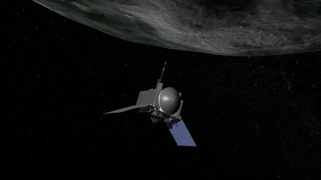 Космический корабль NASA OSIRIS-REx у поверхности астероида Бенну в представлении художника (иллюстрация NASA/Goddard/Chris Meaney).