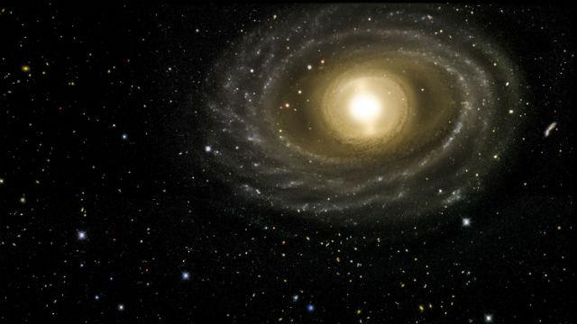 Снимок галактики NGC 1398, полученный при помощи Камеры тёмной энергии (фото Dark Energy Survey).