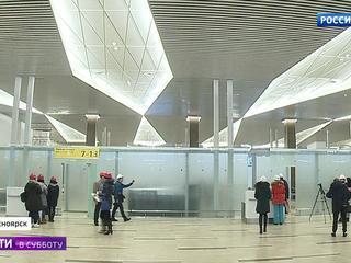 """Новый терминал аэропорта Красноярска: """"самолетный"""" потолок и макет спутника"""